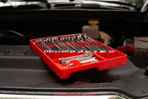Tool Sorter wrench organizer on car engine